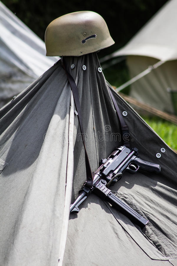 MP 40 and Helmet Hanging on a Tent. MP 40 and helment hanging on a tent in a camp royalty free stock images