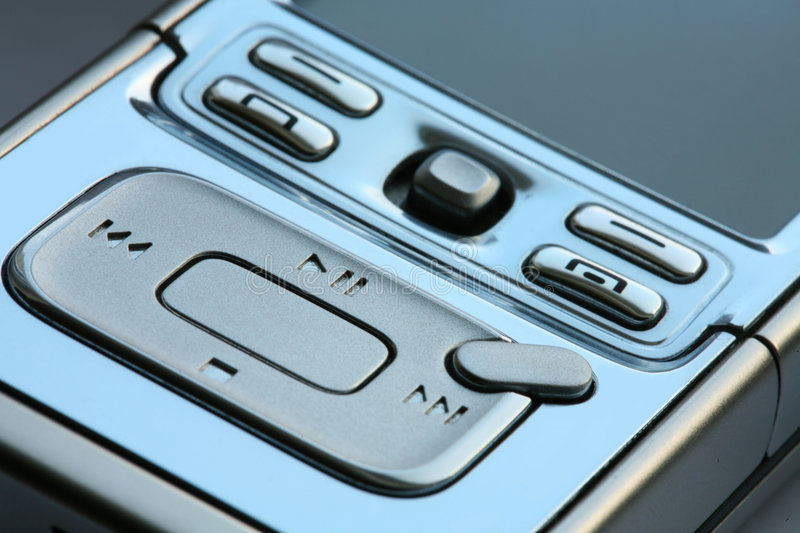 Mp3 media player and phone. Portable mp3 media player and phone royalty free stock photos