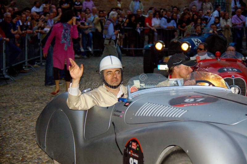 Mr. Bean (Rowan Atkinson) in the Mille Miglia. The English comedian, screenwriter, and actor, Rowan Sebastian Atkinson participates in the Mille Miglia of 2011 stock images