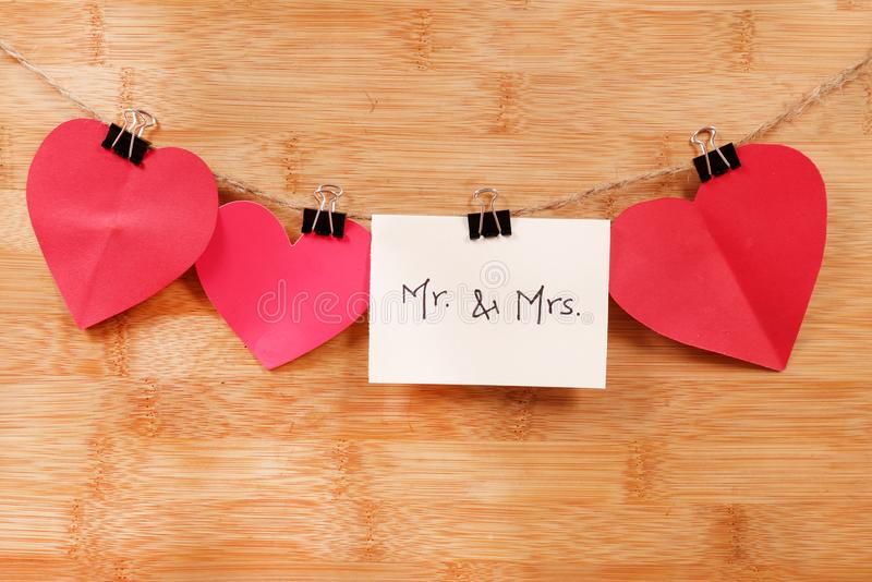 Mr and mrs. Beautiful shot of mr and mrs written on white chit royalty free stock images