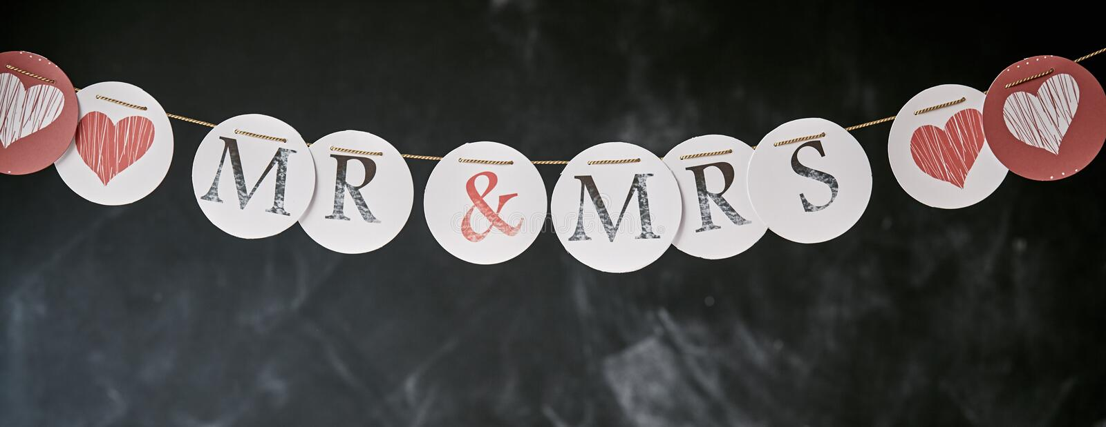Mr and Mrs wedding garland panoramic banner stock photography