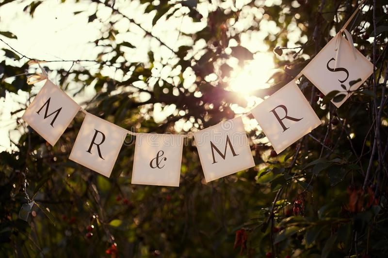 Mr. & Mrs. wedding sign on the flags royalty free stock images