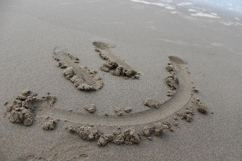 Mr szczęśliwa piasek twarz zdjęcia royalty free