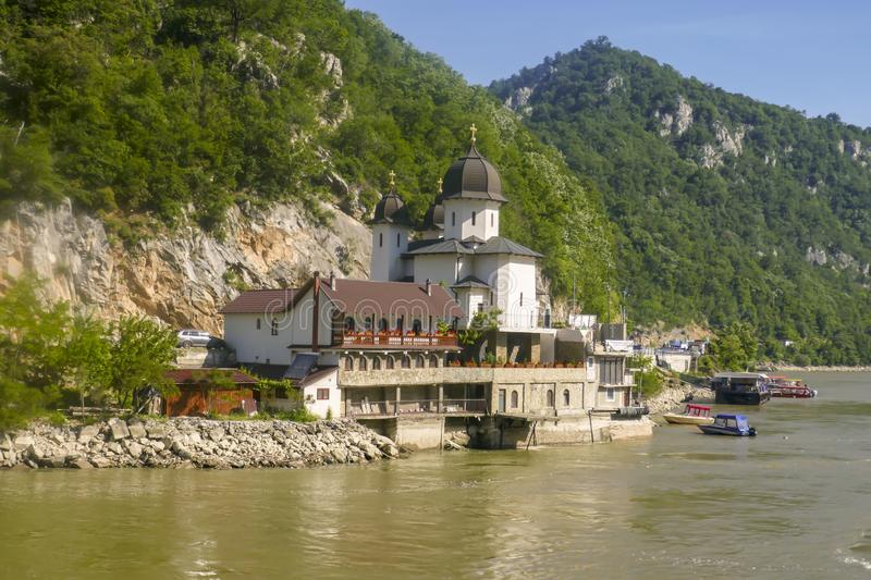 Mraconia Monastery on banks of Danube River. Mraconia Monastery on banks of  the Iron Gate gorges on the Danube River between Serbia and Romania stock photo