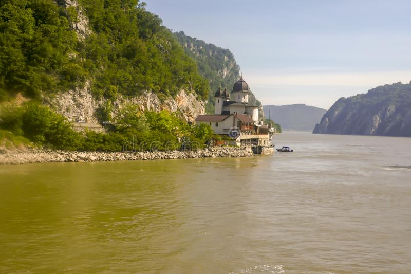 Mraconia Monastery on shores of iron Gate. Mraconia Monastery on shores cruising through the Iron Gate gorges on the Danube River between Serbia and Romania royalty free stock photos