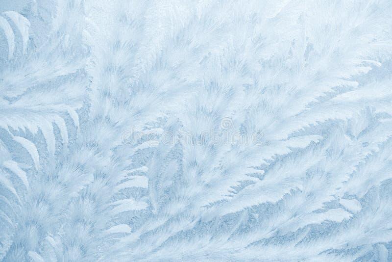 Mrozów wzory na nadokiennym szkle w zimie przyprawiają tekstury szkła tekstura niebieska tła fotografia royalty free