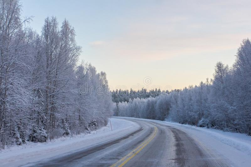 Winter roads. View from the car on winter roads stock image