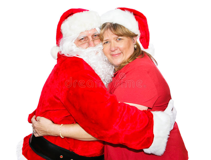 Mrs Claus Hugs Santa stock images