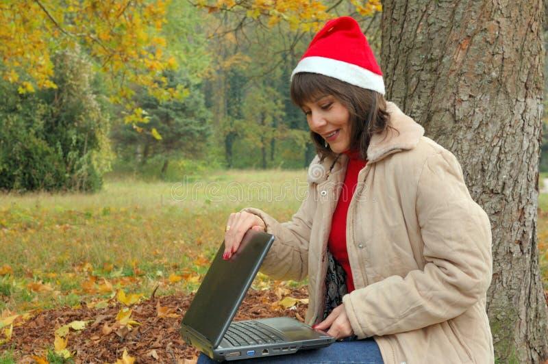 Mrs Santa Laptop stock photo