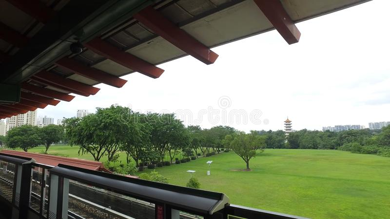 An MRT train in Singapore at the station on green trees background. Shot. Singapore mass rapid train MRT at the station. royalty free stock photo