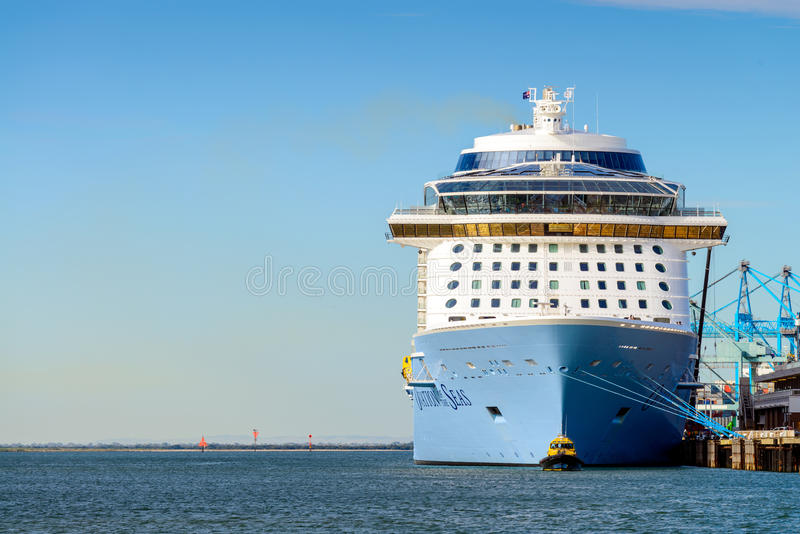MS Ovation of the Seas and Port Security boat. Port Adelaide, South Australia, February 14, 2017: MS Ovation of the Seas cruise ship and Port Security boat in stock images