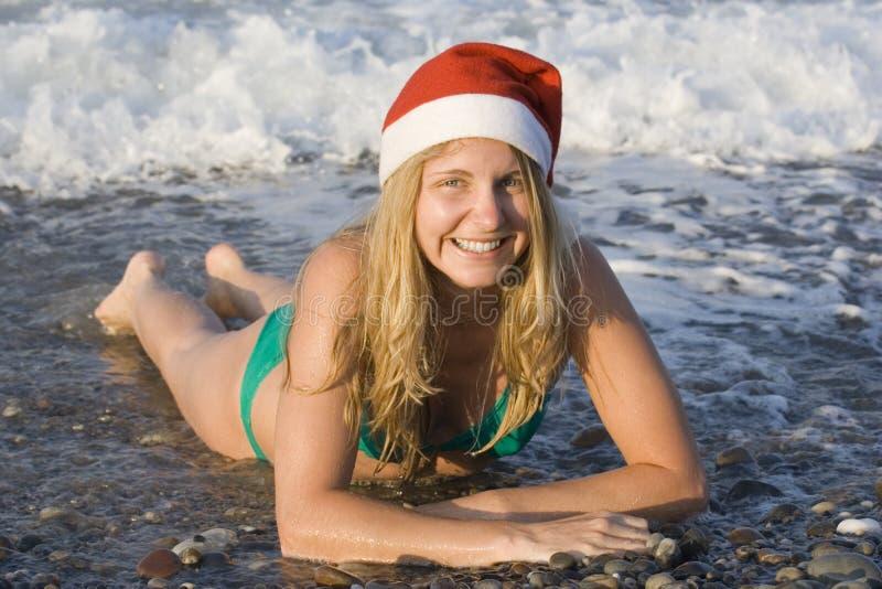 Ms santa in the ocean stock photo