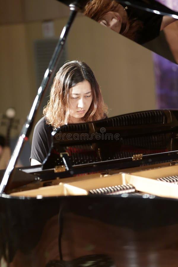 Ms yujiawen play piano. Teacher yujiawen of xiamen xinghe (star river) art center playing piano, amoy city, china royalty free stock photo