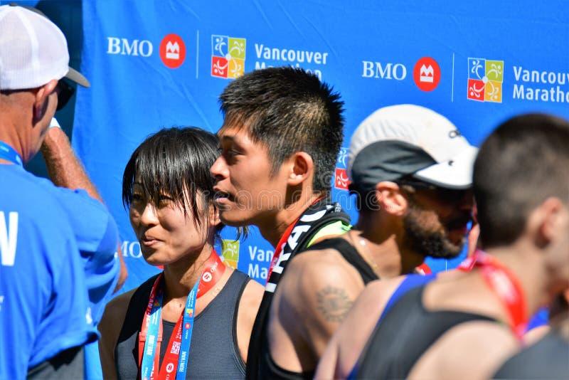 Ms. Yuko Mizuguchi won female 1st place at Vancouver maraton.Mr.Yuki Kawauchi won 1st place at Vancouver maraton. royalty free stock photos