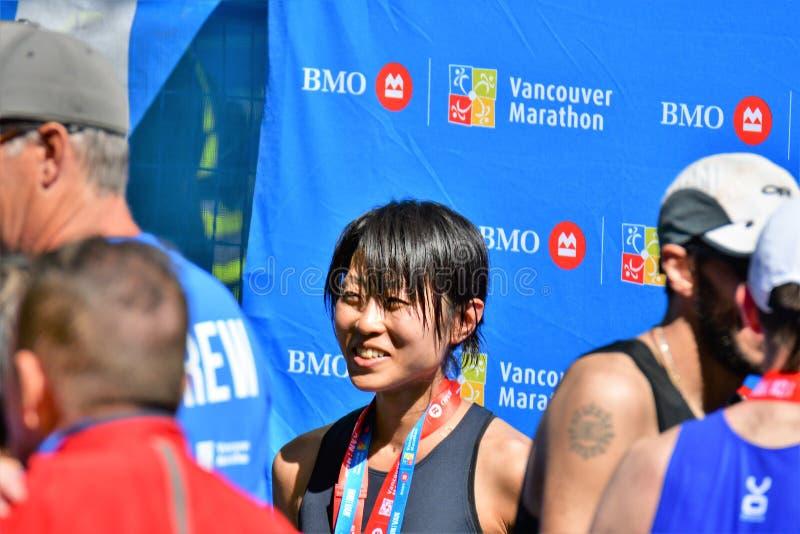 Ms. Yuko Mizuguchi won female 1st place at Vancouver maraton. stock photography