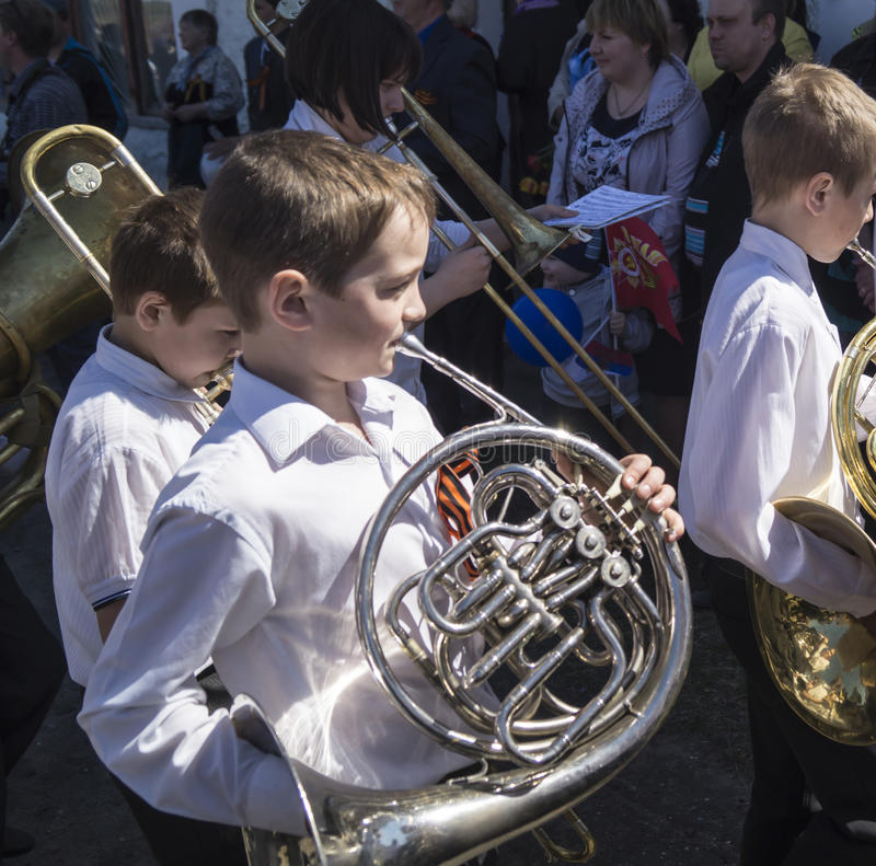 Mstyora,Russia-May 9,2015: Baby brass band. Children play on music instrument on holiday in honour of day of the Victory in city Mstyora,Russia stock photography