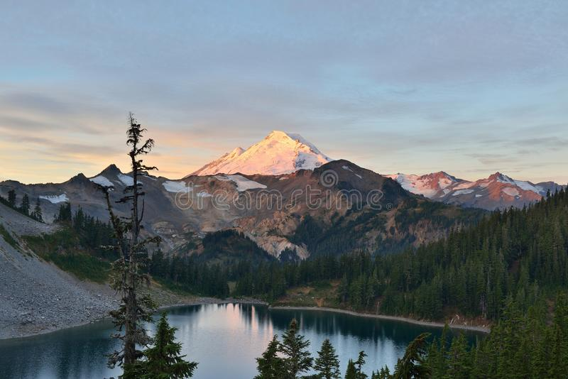 Mt. Baker and Iceberg Lake viewed from Herman Saddle at sunrise stock photo