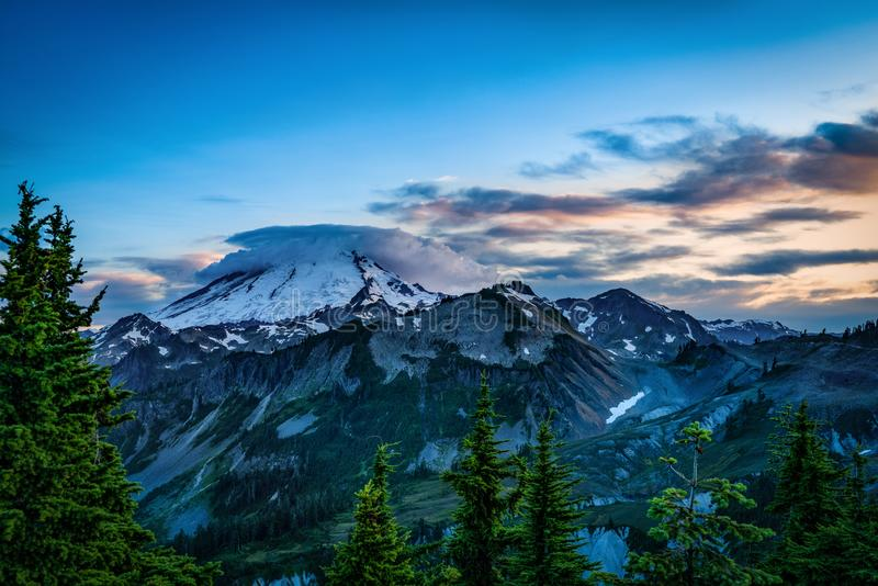 MT BAKER NATIONAL FOREST WA STATE. MT BAKER NATIONAL FOREST MT BAKER WITH CLOUDY SKY AT SUNSET royalty free stock images