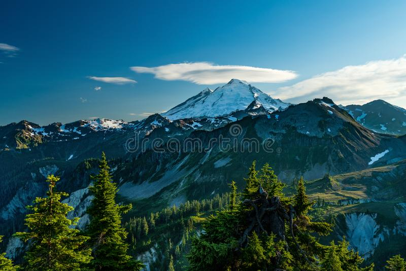 MT BAKER NATIONAL FOREST WA STATE. MT BAKER NATIONAL FOREST AT SUNSET  WITH CLOUD HALO ABOVE MT BAKER royalty free stock photos
