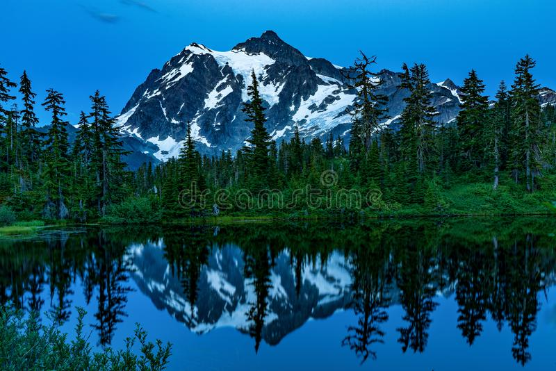 MT BAKER NATIONAL FOREST WA STATE. MT BAKER NATIONAL FOREST MT BAKER LAKE WITH REFLECTION OF MT SHUKSAN royalty free stock photos