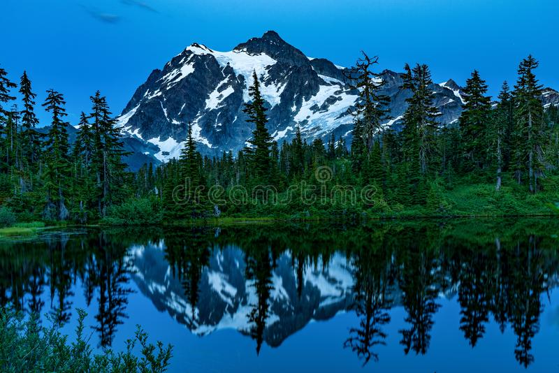 MT BAKER NATIONAL FOREST WA STATE. MT BAKER NATIONAL FOREST AT SUNSET  LAKE REFLECTION OF MT SHUKSAN stock photo