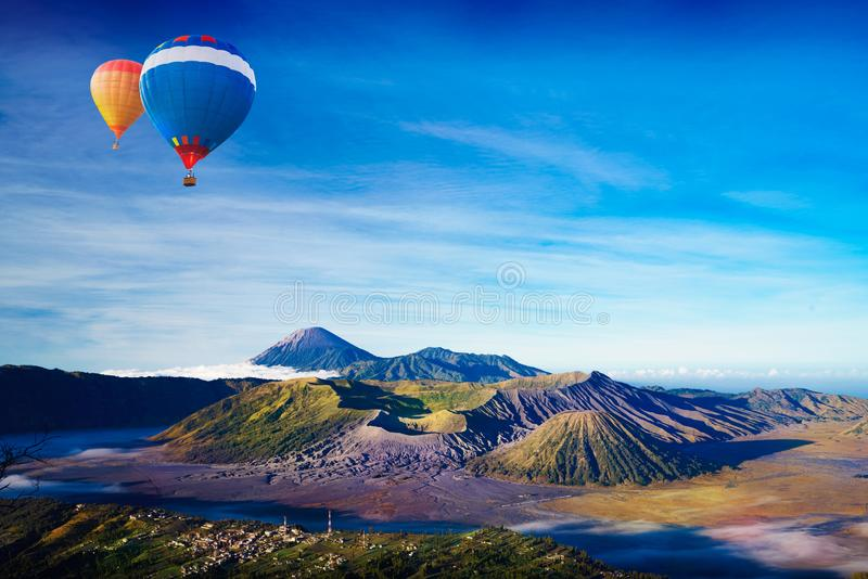 Mt. Bromo. Colorful hot-air balloon flying over Mt. Bromo, Indonesia royalty free stock images