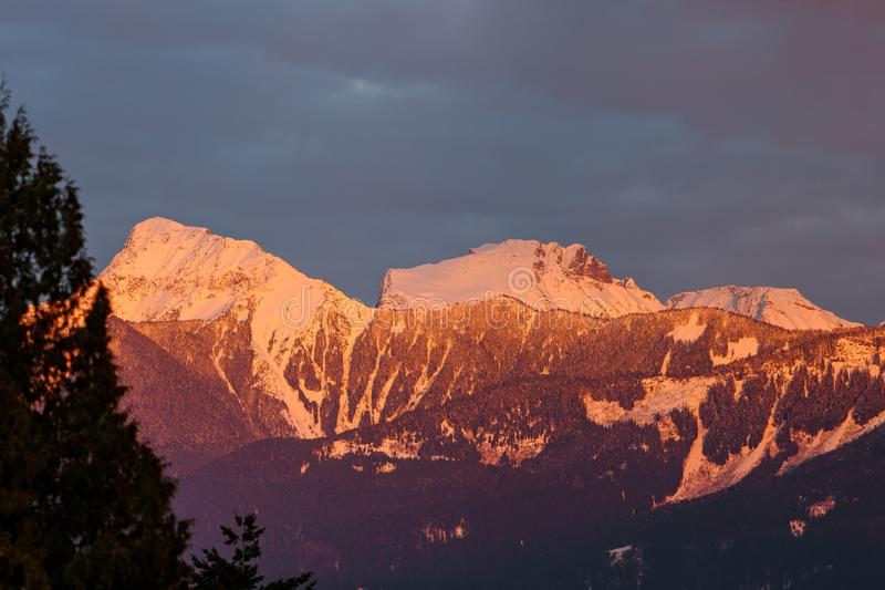 Mt. Cheam at sunset, Chilliwack, British Columbia, Canada. Sunset over the Mt. Cheam, Chilliwack, British Columbia, Canada royalty free stock image