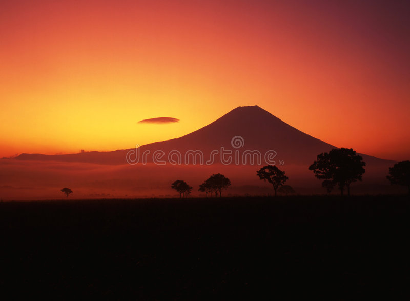 Mt fuji-426. A fiery sunrise over the silhouette of sacred Fuji royalty free stock photo
