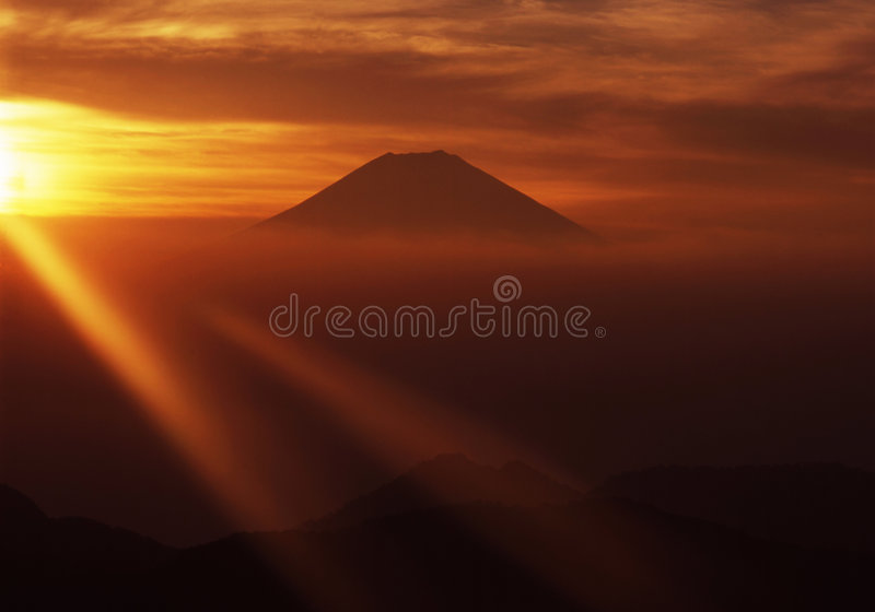 Mt fuji-467. Golden sunrise line over Mt. Fuji as viewed from an adjacent peak royalty free stock photography