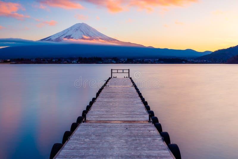 Mt. Fuji with a leading dock in Lake Kawaguchi, Japan stock image