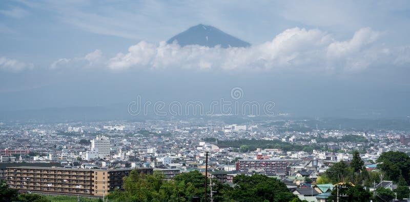 Mt.Fuji over Fujinomiya, Shizuoka, Japan stock images