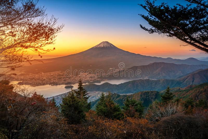 Mt. Fuji over Lake Kawaguchiko with autumn foliage at sunrise in Fujikawaguchiko, Japan royalty free stock photography