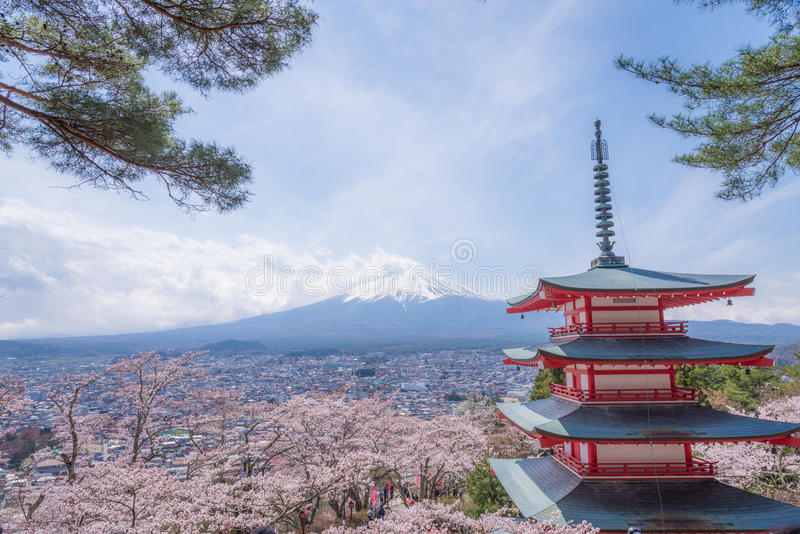 The Mt.Fuji in a part cloudy day with cheery blossom or Sakura. The landscape is also took with others Japanese landmark. Landscape stock photos