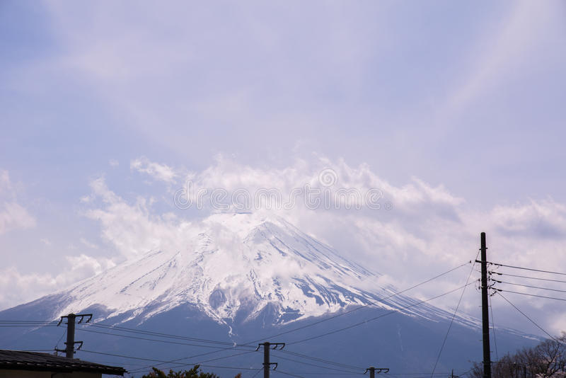 The Mt.Fuji in a part cloudy day with cheery blossom or Sakura. The landscape is also took with others Japanese landmark. Landscape royalty free stock image