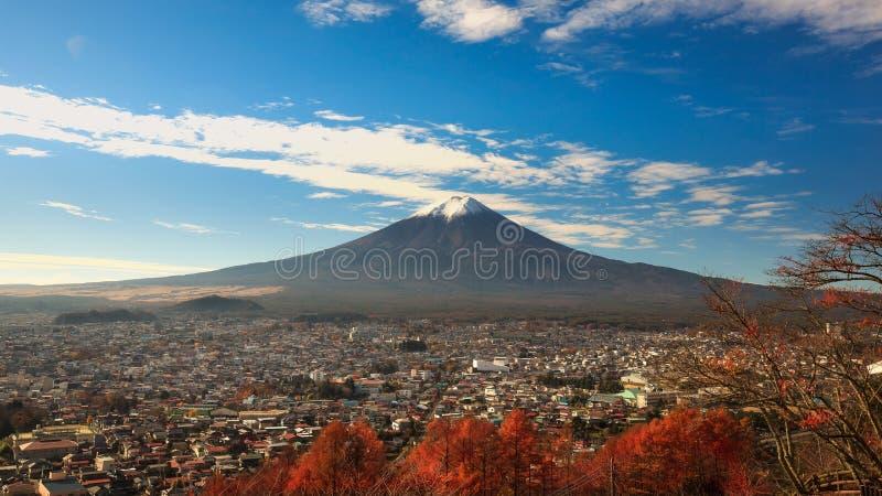 Mt. Fuji rises over Fujiyoshida, Japan stock photography
