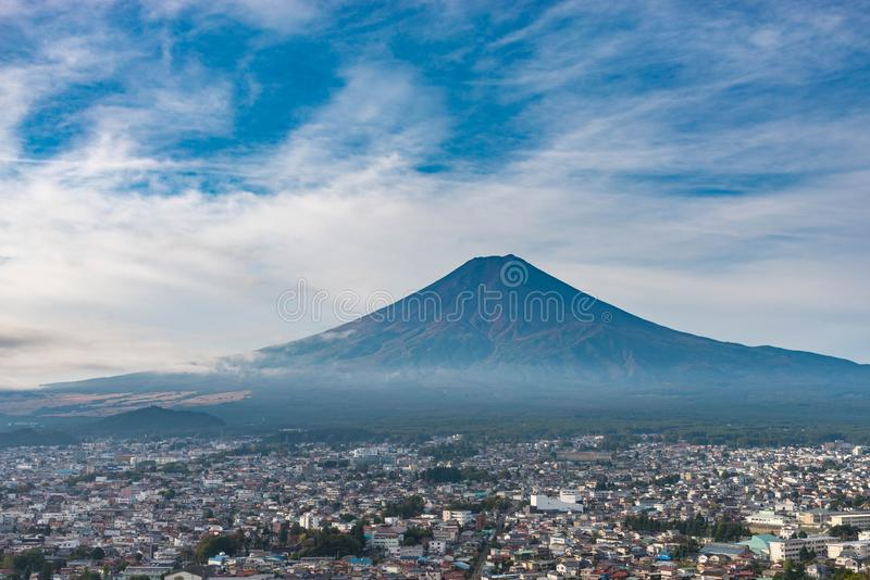Mt. Fuji in summer with clouds, blue sky and city near the foot of mountain from viewpoint royalty free stock image
