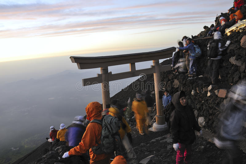 Mt.Fuji sunrise. Mt.Fuji peak, Yamanashi, Japan - July 13, 2008: Hikers gathering sunrise on the Mt.Fuji summit. Traditionally Japanese hikers climb mt.Fuji by stock photography