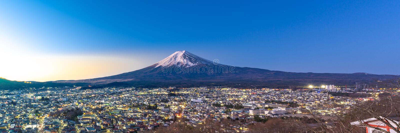 Mt.Fuji Sunrise. Mt.Fuji and Fujiyoshida town sunrise panorama stock image