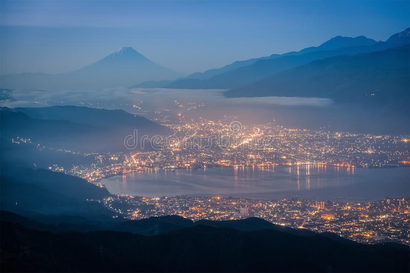 Mt.Fuji and Suwa lake in early morning stock images