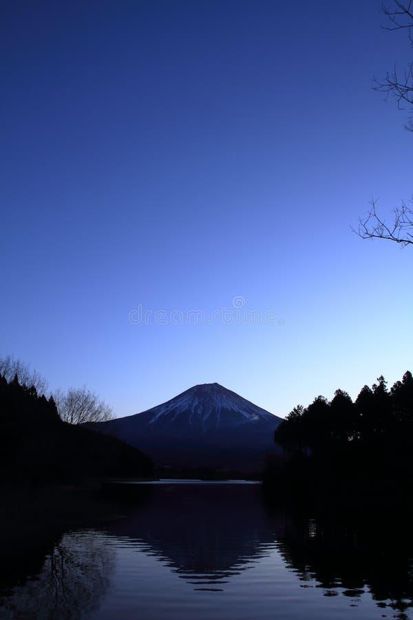 Mt. Fuji, view from Tanuki lake before dawn. Mt. Fuji, view from Tanuki lake, Shizuoka, Japan before dawn stock photo