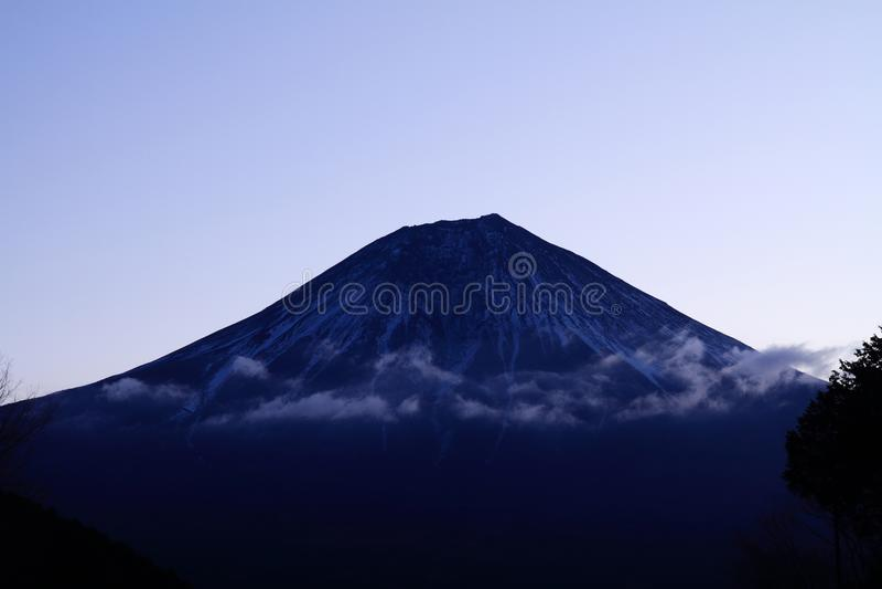 Mt. Fuji, view from Tanuki lake before dawn. Mt. Fuji, view from Tanuki lake, Shizuoka, Japan before dawn royalty free stock photos