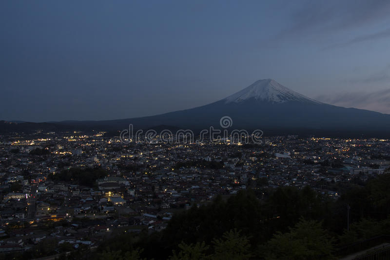 Mt Fuji view in twilight. Mt Fuji with city view in twilight royalty free stock images