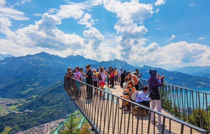 People on the observation platform on Mt. Harder in Switzerland. Mt. Harder, Switzerland - August 7, 2018: people on the observation platform on the Harderkulm royalty free stock images