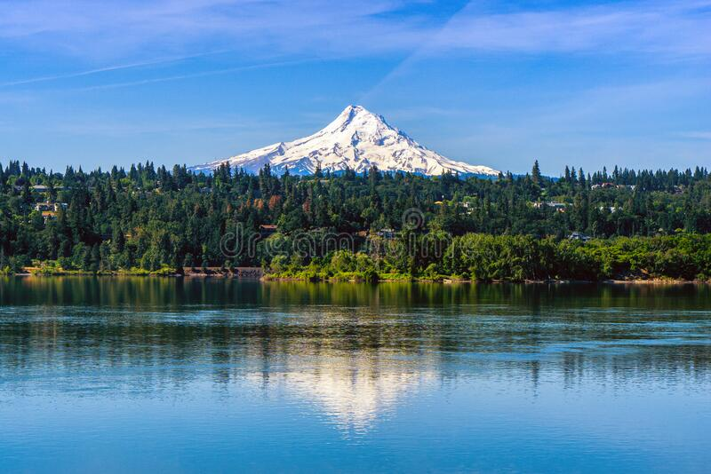 Mt Hood covered with snow over Hood River and reflecting on the Columbia River, Oregon. Shot taken from Washington state. USA stock photos