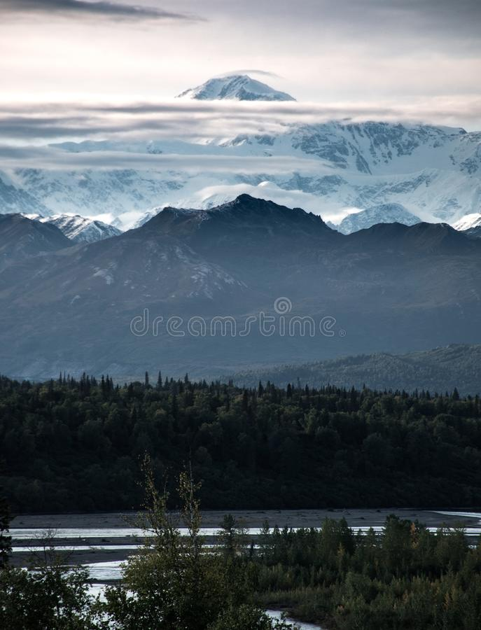 Mt. McKinley peaks between the clouds in Denali National Park stock image