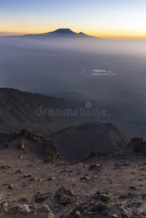 Mt Meru & Kilimanjaro at sunrise. Mount Meru with Mt Kilimanjaro in the distance near Arusha in Tanzania. Africa. Mt Meru is located 60 kilometres west of Mount stock photos