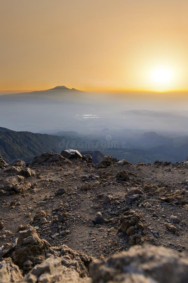 Mt Meru & Kilimanjaro at sunrise. Mount Meru with Mt Kilimanjaro in the distance near Arusha in Tanzania. Africa. Mt Meru is located 60 kilometres west of Mount royalty free stock photos