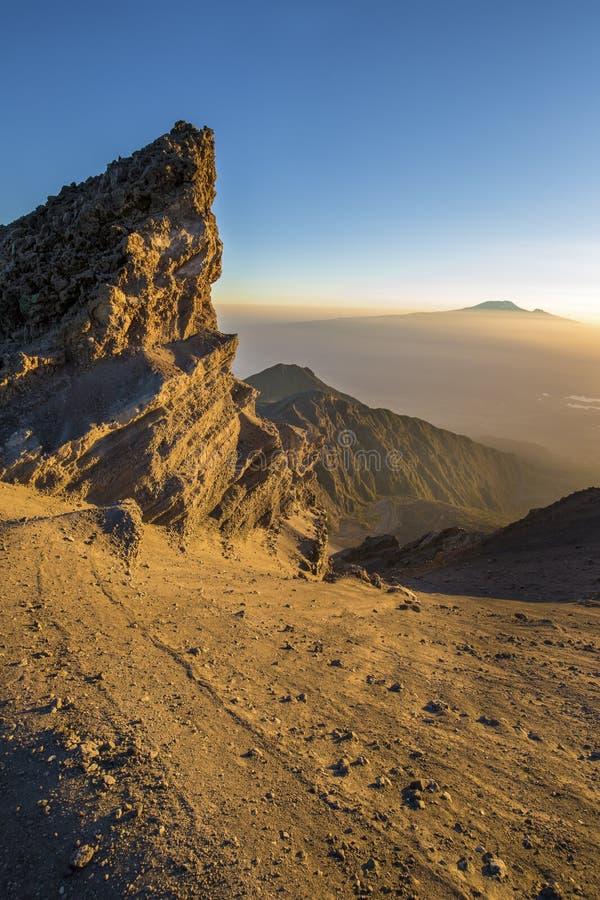 Mt Meru & Kilimanjaro at sunrise. Mount Meru with Mt Kilimanjaro in the distance near Arusha in Tanzania. Africa. Mt Meru is located 60 kilometres west of Mount stock image