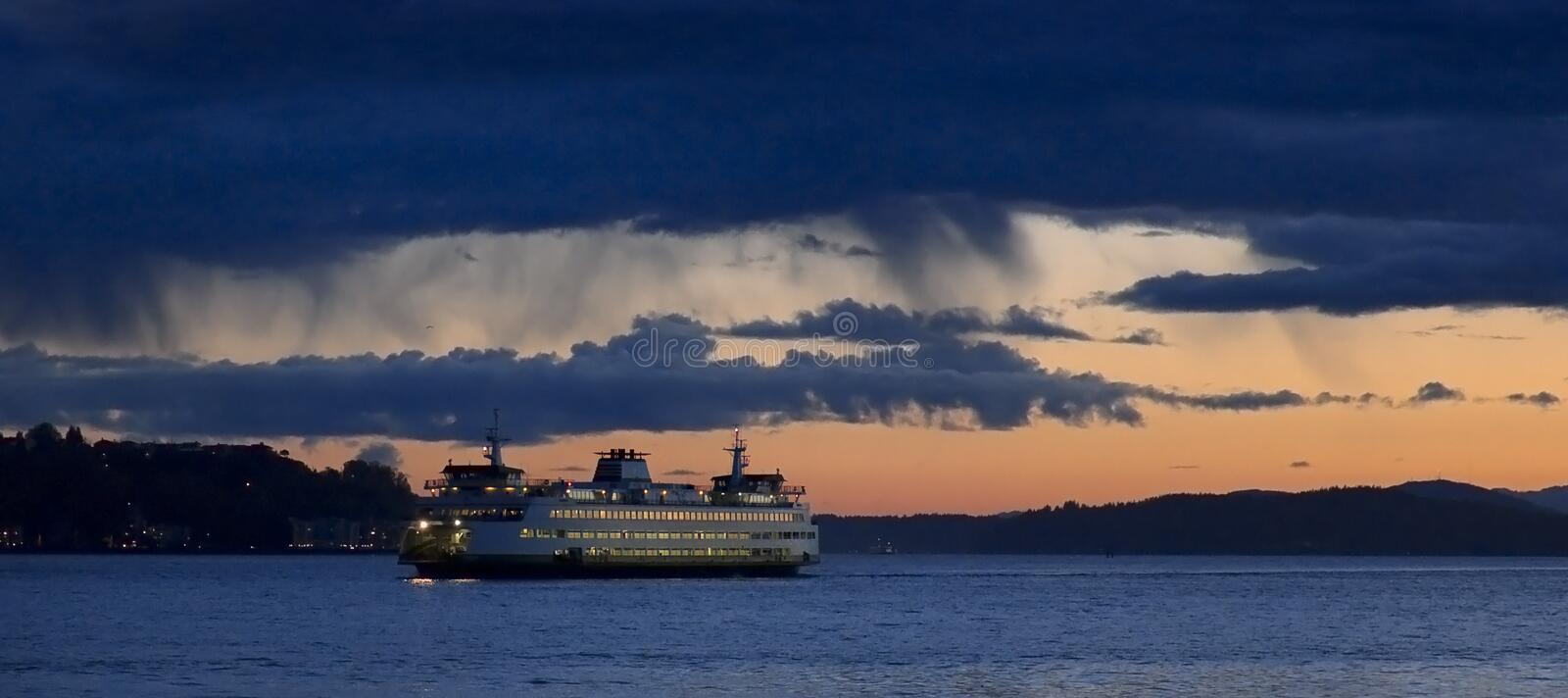 Washington State ferry on Puget Sound near Seattle. Washington State ferry boat crossing Puget Sound at sunset near the Seattle waterfront stock photography