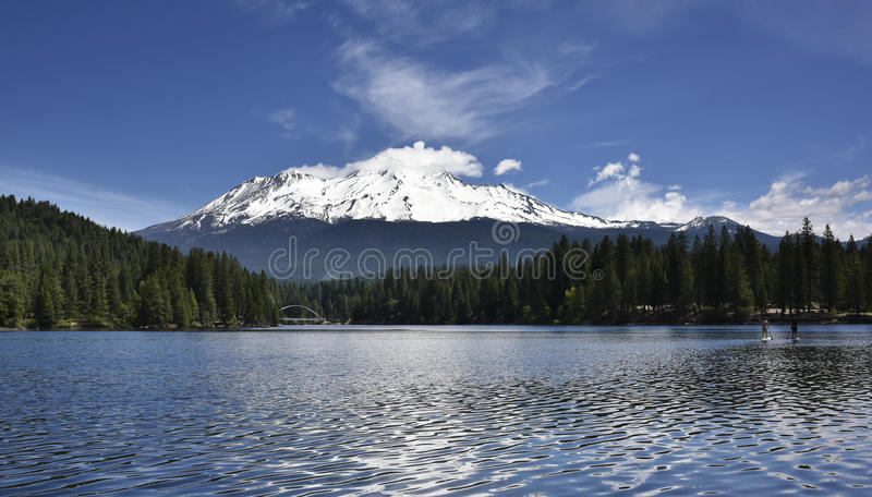 Mt Shasta reflected in Siskiyou Lake at Sunset royalty free stock photography
